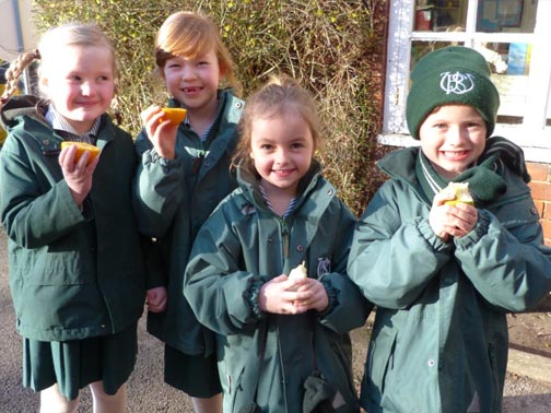 Pupils at Wilmslow Prep School eating fruit in the playground